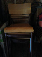 25 hard stackable wooded/metal chairs