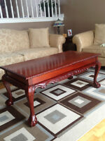 Mahogany  coffe table with matching end tables. ball & claw feet