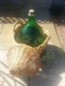 wine carboys  with wicker baskets