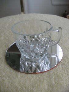 A LITTLE CLEAR PRESSED-GLASS HANDLED MUG