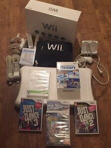Nintendo wii with wii balance board games and more.
