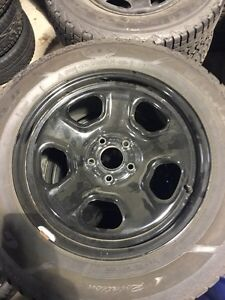 Goodyear ultra grip snow and ice tires  with rims and sensors