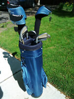 Golf clubs with bag and head covers