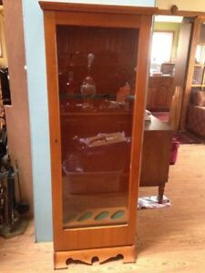older style cabinet could be used to store hunting bows eq