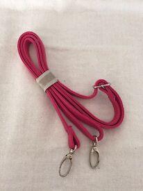 Pink handbag strap