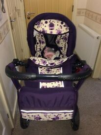 Purple owl pushchair