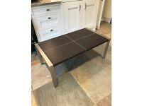 Brown leather topped coffee table