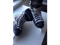 Black and white Reebok ice skates