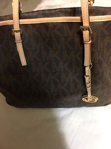 Two Michael Kors (MK) bags