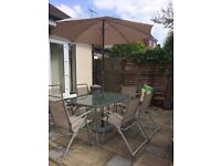 Garden furniture includes Table , Chairs , Parasol &Base SOLD