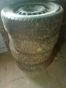 4 studded winter tires with steel rims