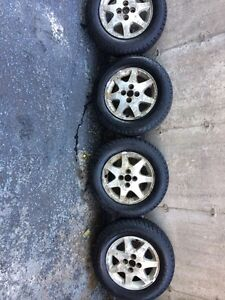 LIKE NEW COOPER WEATHER MASTER WINTER TIRES STUDDED ON RIMS