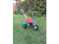 Children's trike with handle. Similar to smartrike and fisher price