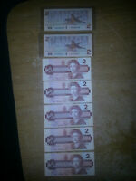 I HAVE 7 MINT UNCIRCULATED 1986 2$ BILLS FOR SALE 7$ EACH.