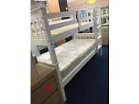 White single bunk beds