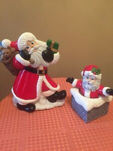 2 ceramic Santas Christmas one is musical