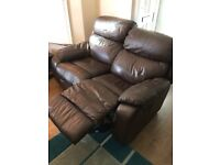 2 seater brown leather recliner. Offers