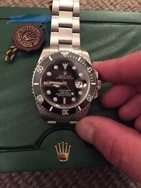 Rolex submariner SWISS ..crown etched in glass SERIAL NUMBERS ..box and papers