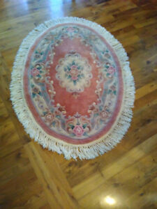 Two wool Round area rugs