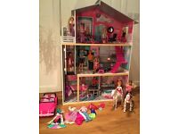 Dolls house with 13 dolls, car, 2 horses (1 moving) and dolls clothes