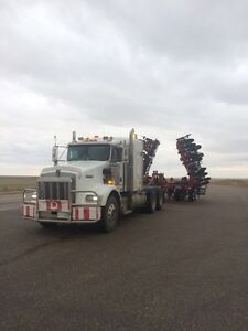 Custom agriculture and construction equipment hauling and towing