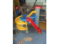 Fisher price garage and graco high chair