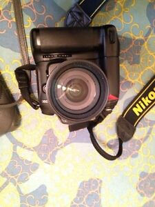 Nikon D90 with 18-70 mm and MD-80