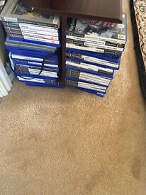 Sony slimline silver ps2 with 60 games two pads