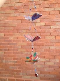 Hand painted glass butterfly mobile.