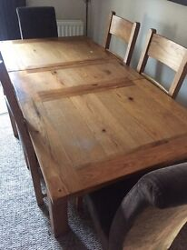 Harvey's 6 seater extendable wooden table with 6 chairs