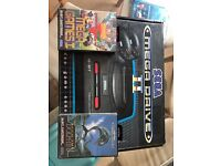 Boxed SEGA MEGADRIVE 2 console with 2 pads and games