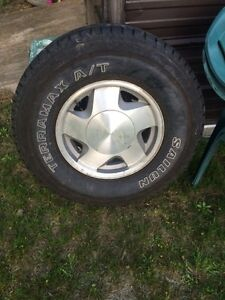 Four 6 bolt Chevy rims and tires
