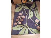 Green and brown rug