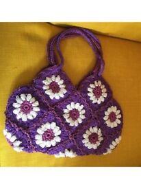 Purple crocheted handbag