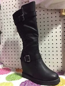 Brand new women's wedge boots size 8 and 9. $40/pair
