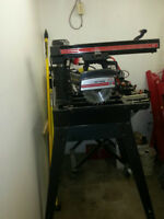 Craftsman 10 inch radial arm saw on rolling legs