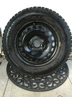 Four steel rim with studded tires - VW Jetta