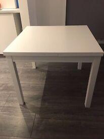 Ikea burjusta white extending dining table