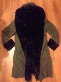 Never been worn khaki coat with black fauxs. Size 10-12..reduced to £7!