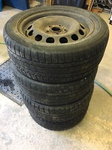 Used winter tires with rims.