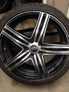 19 INCH RIMS WITH TIRES ( NOTE 1RIM HAS A SMALL CRACKED