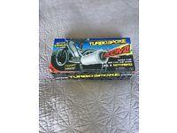 Turbospoke kids bicycle exhaust system