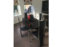 Smoked glass dining table extendable and 4 chairs