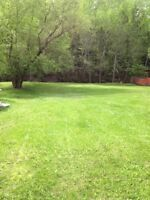private landscaped building lot, garage, hook ups close to town
