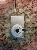 Canon SD1000 digital camera w/ 2GB SD card and 2 batteries