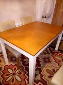 Solid Oak and Cream extendable Dining Room Table with 4 Flaux leather cream Chairs