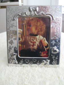 An ADORABLE LITTLE SILVER PLATED CHILD'S STAND-UP PICTURE FRAME