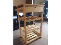 Kitchen utility/chopping block wine rack thingy.