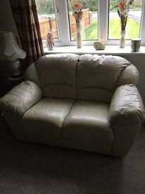 2 x Two Seater sofas in Cream leather.