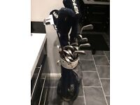 full set of arnold palmer golf clubs inc 3 woods and 1 putter also complete with howson golf bag